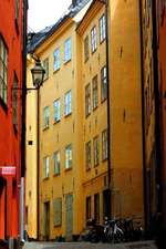Bicycles and Colorful Buildings on a Street in Old Town Stockholm Sweden Journal